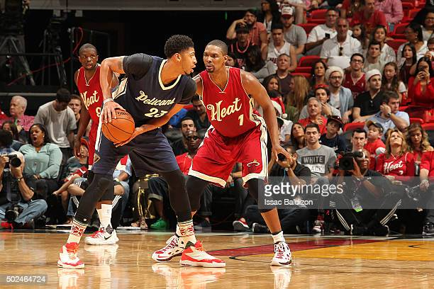 Anthony Davis of the New Orleans Pelicans handles the ball against Chris Bosh of the Miami Heat on December 25 2015 at American Airlines Arena in...