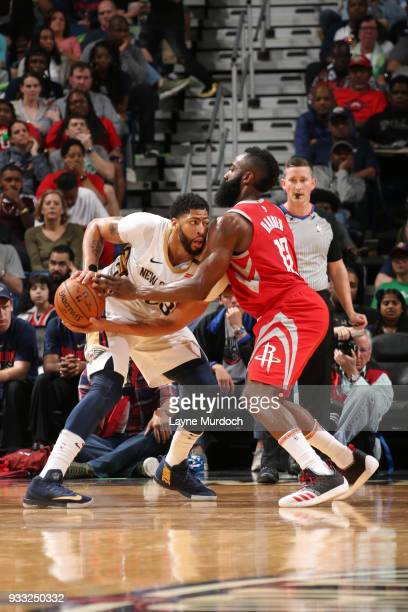 Anthony Davis of the New Orleans Pelicans handles the ball against James Harden of the Houston Rockets during the game between the two teams on March...