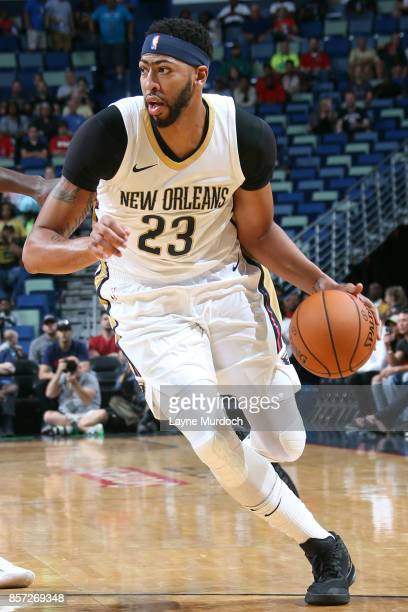 Anthony Davis of the New Orleans Pelicans handles the ball during a preseason game against the Chicago Bulls on October 3 2017 at the Smoothie King...