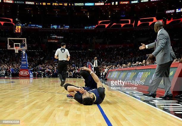 Anthony Davis of the New Orleans Pelicans holds his right knee and grimaces in pain after an injury during the third quarter the basketball game...