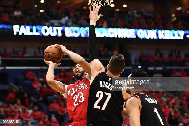 Anthony Davis of the New Orleans Pelicans is defended by Jusuf Nurkic of the Portland Trail Blazers during Game Four of the first round of the...