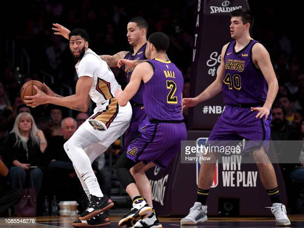 Anthony Davis of the New Orleans Pelicans is defended by Kyle Kuzma Lonzo Ball and Ivica Zubac of the Los Angeles Lakers during a 112104 Laker win at...