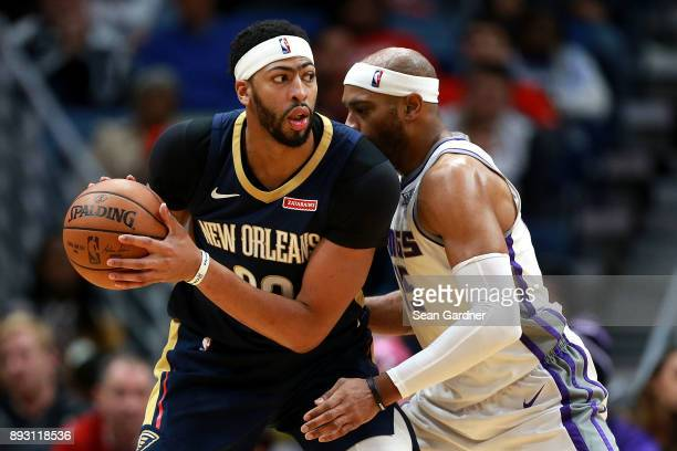 Anthony Davis of the New Orleans Pelicans is defended by Vince Carter of the Sacramento Kings during the second half of a NBA game at the Smoothie...