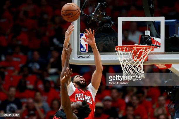 Anthony Davis of the New Orleans Pelicans is fouled by AlFarouq Aminu of the Portland Trail Blazers during Game 3 of the Western Conference playoffs...