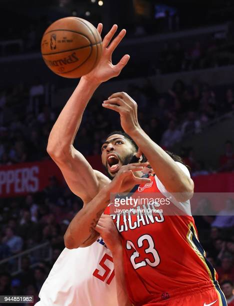 Anthony Davis of the New Orleans Pelicans is fouled by Boban Marjanovic of the Los Angeles Clippers as he goes to the basket in the game at Staples...