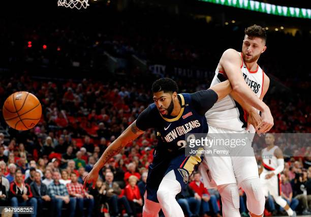 Anthony Davis of the New Orleans Pelicans is guarded by Jusuf Nurkic of the Portland Trail Blazers during Game One of the Western Conference...