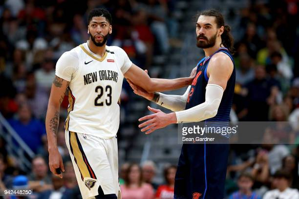 Anthony Davis of the New Orleans Pelicans is guarded by Steven Adams of the Oklahoma City Thunder during the first half of a NBA game at the Smoothie...