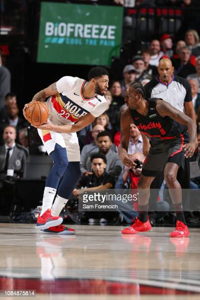 Anthony Davis of the New Orleans Pelicans jocks for a position during the game against AlFarouq Aminu of the Portland Trail Blazers on January 18...