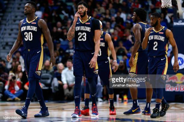 Anthony Davis of the New Orleans Pelicans Julius Randle and Ian Clark react during a game against the Dallas Mavericks at the Smoothie King Center on...