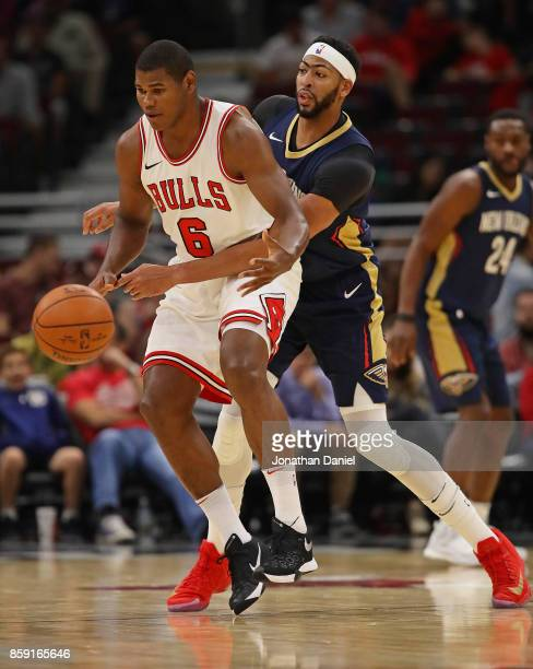 Anthony Davis of the New Orleans Pelicans knocks the ball away from Cristiano Felicio of the Chicago Bulls during a preseason game at the United...