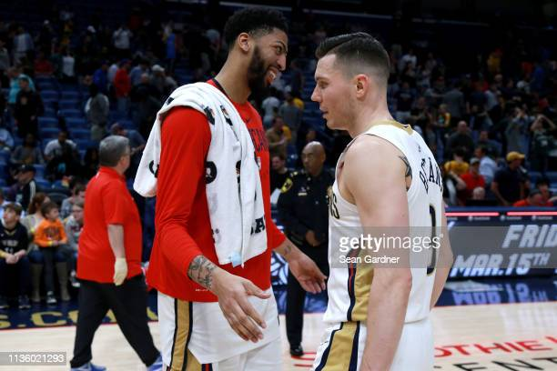 Anthony Davis of the New Orleans Pelicans laughs with Dairis Bertans of the New Orleans Pelicans after a NBA game against the Milwaukee Bucks at the...