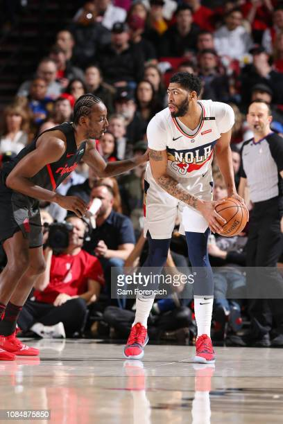 Anthony Davis of the New Orleans Pelicans looks to pass the ball during the game against AlFarouq Aminu of the Portland Trail Blazers on January 18...