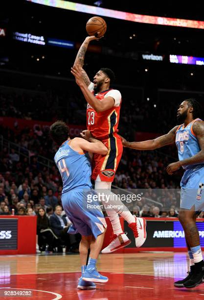 Anthony Davis of the New Orleans Pelicans makes a floater against Milos Teodosic of the Los Angeles Clippers on March 6 2018 at STAPLES Center in Los...
