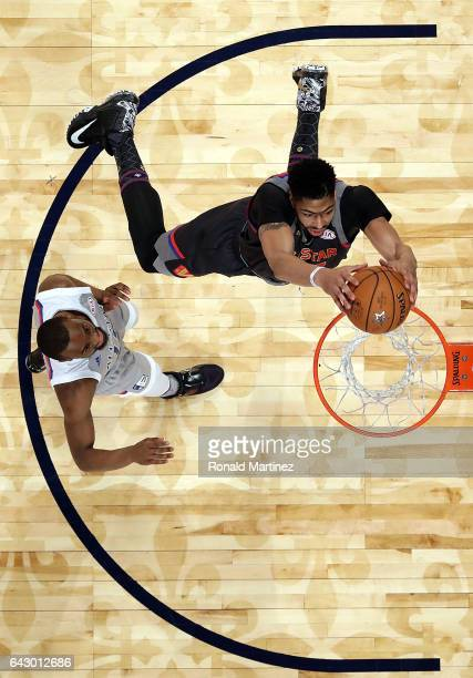 Anthony Davis of the New Orleans Pelicans makes a slam dunk against Kyrie Irving of the Cleveland Cavaliers during 2017 NBA AllStar Game at Smoothie...