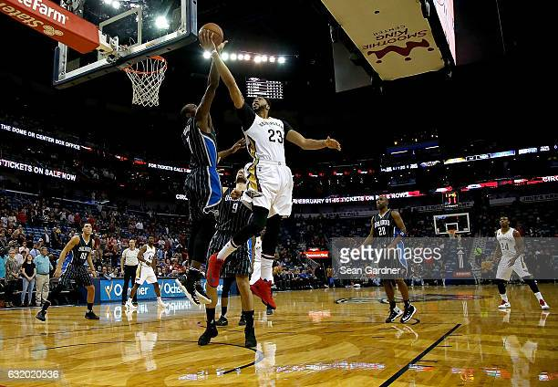 Anthony Davis of the New Orleans Pelicans of the New Orleans Pelicans is blocked by Serge Ibaka of the Orlando Magic during the first half at the...