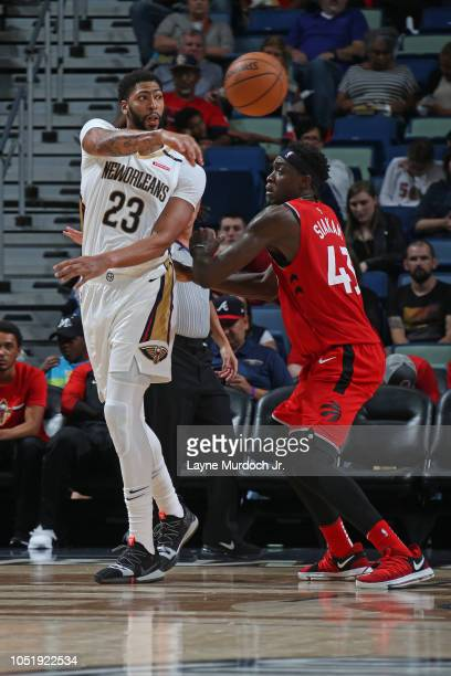 Anthony Davis of the New Orleans Pelicans passes the ball against the Toronto Raptors during a preseason game on October 11 2018 at Smoothie King...