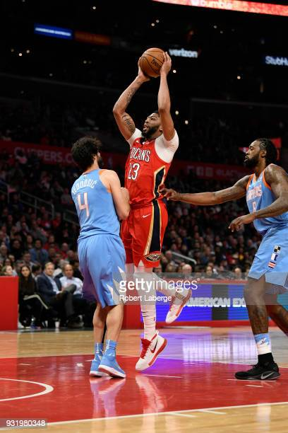 Anthony Davis of the New Orleans Pelicans plays against Milos Teodosic of the Los Angeles Clippers on March 6 2018 at STAPLES Center in Los Angeles...