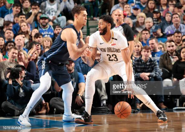 Anthony Davis of the New Orleans Pelicans posts up against Dwight Powell of the Dallas Mavericks on December 26 2018 at the American Airlines Center...