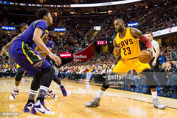 Anthony Davis of the New Orleans Pelicans puts pressure on LeBron James of the Cleveland Cavaliers during the first half at Quicken Loans Arena on...