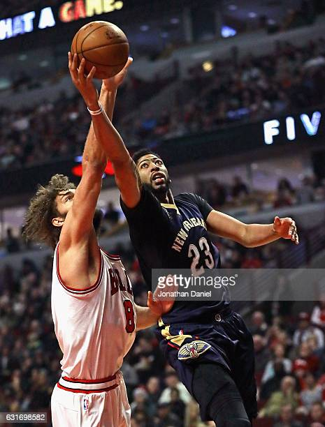 Anthony Davis of the New Orleans Pelicans puts up a shot against Robin Lopez of the Chicago Bulls at the United Center on January 14 2017 in Chicago...