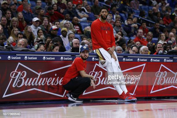 Anthony Davis of the New Orleans Pelicans reacts in front of the Budweiser logo during the second half against the LA Clippers at the Smoothie King...