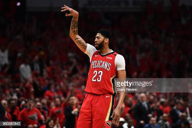 Anthony Davis of the New Orleans Pelicans reacts to a three point shot against the Portland Trail Blazers during Game Four of the first round of the...