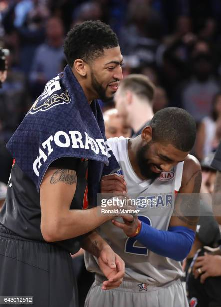 Anthony Davis of the New Orleans Pelicans reacts with Kyrie Irving of the Cleveland Cavaliers after the 2017 NBA AllStar Game at Smoothie King Center...