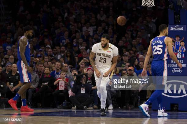 Anthony Davis of the New Orleans Pelicans runs down the court in the second quarter past Amir Johnson and Ben Simmons of the Philadelphia 76ers after...