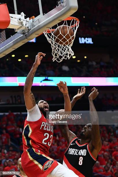 Anthony Davis of the New Orleans Pelicans scores against AlFarouq Aminu of the Portland Trail Blazers during Game Four of the first round of the...