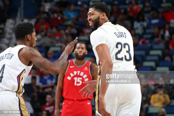 Anthony Davis of the New Orleans Pelicans shakes teammates hands during a preseason game against the Toronto Raptors on October 11 2018 at Smoothie...