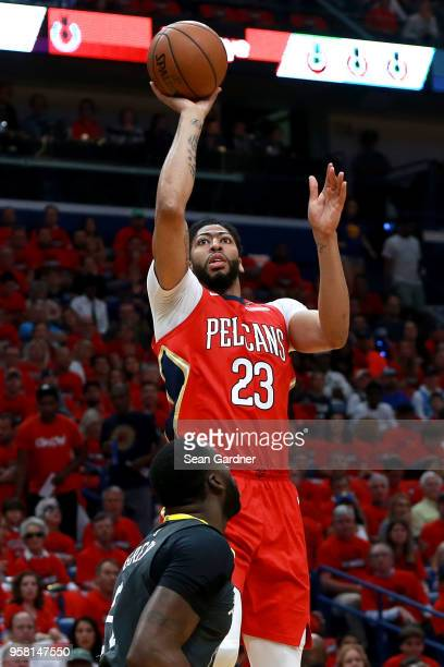 Anthony Davis of the New Orleans Pelicans shoot over Draymond Green during Game Four of the Western Conference Semifinals of the 2018 NBA Playoffs at...