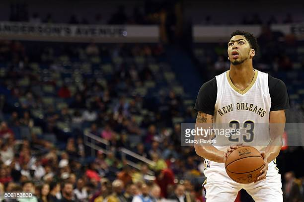 Anthony Davis of the New Orleans Pelicans shoots a free throw during the first half of a game against the Detroit Pistons at the Smoothie King Center...