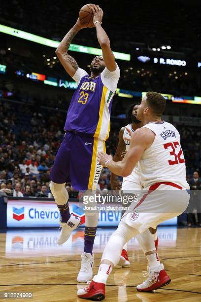 Anthony Davis of the New Orleans Pelicans shoots against Blake Griffin of the LA Clippers druing the first half at the Smoothie King Center on...