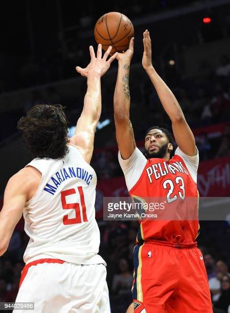 Anthony Davis of the New Orleans Pelicans shoots against Boban Marjanovic of the Los Angeles Clippers in the second half of the game at Staples...