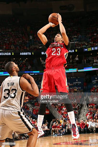 Anthony Davis of the New Orleans Pelicans shoots against Boris Diaw of the San Antonio Spurs during the game on April 15 2015 at Smoothie King Center...