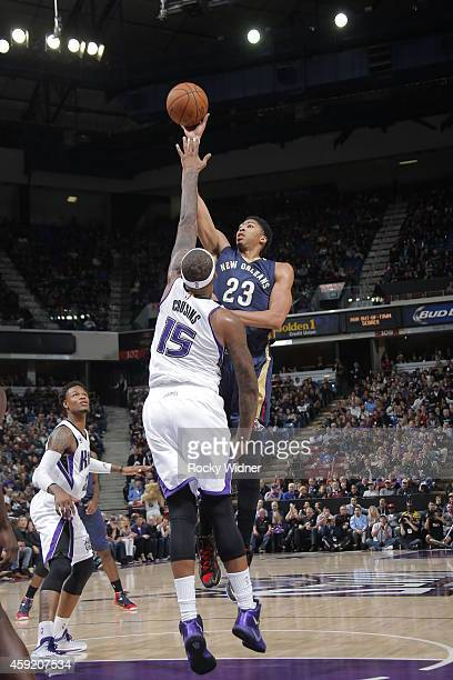 Anthony Davis of the New Orleans Pelicans shoots against DeMarcus Cousins of the Sacramento Kings on November 18 2014 at Sleep Train Arena in...