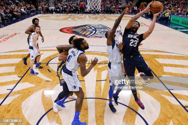 Anthony Davis of the New Orleans Pelicans shoots against Harrison Barnes of the Dallas Mavericks a game at the Smoothie King Center on December 28...