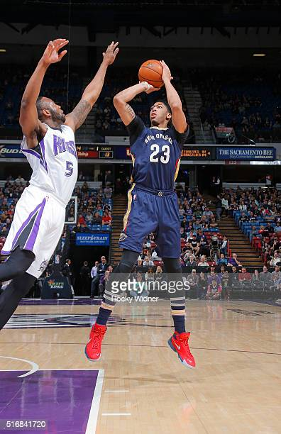 Anthony Davis of the New Orleans Pelicans shoots against James Anderson of the Sacramento Kings on March 16 2016 at Sleep Train Arena in Sacramento...