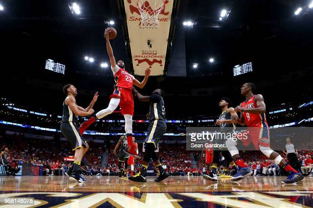 Anthony Davis of the New Orleans Pelicans shoots over Draymond Green during Game Four of the Western Conference Semifinals of the 2018 NBA Playoffs...