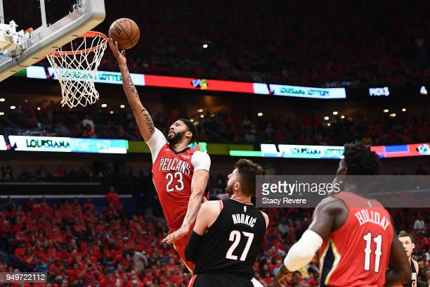 Anthony Davis of the New Orleans Pelicans shoots over Jusuf Nurkic of the Portland Trail Blazers during the second half of Game Four of the first...
