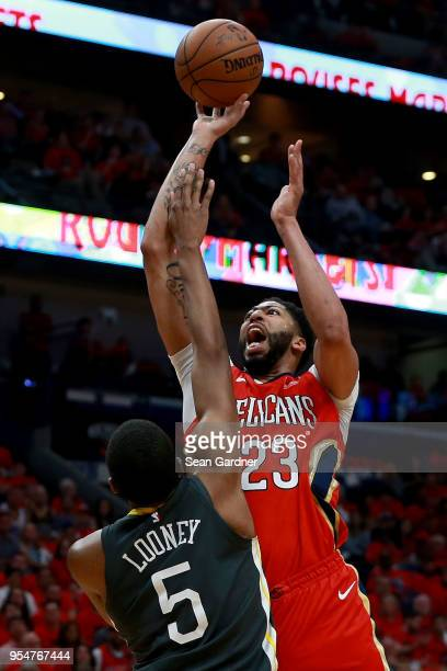Anthony Davis of the New Orleans Pelicans shoots over Kevon Looney of the Golden State Warriors during the first half of Game Three of the Western...