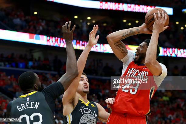 Anthony Davis of the New Orleans Pelicans shoots over Klay Thompson of the Golden State Warriors and Draymond Green of the Golden State Warriors...