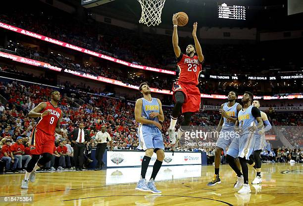 Anthony Davis of the New Orleans Pelicans shoots over Will Barton of the Denver Nuggets during the second quarter at the Smoothie King Center on...