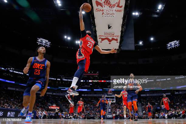 Anthony Davis of the New Orleans Pelicans shoots past Terrance Ferguson of the Oklahoma City Thunder during the first half at the Smoothie King...