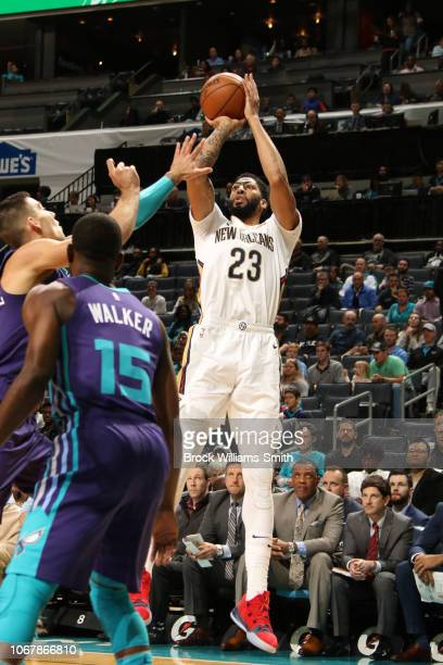 Anthony Davis of the New Orleans Pelicans shoots the ball against the Charlotte Hornets on December 2 2018 at Spectrum Center in Charlotte North...