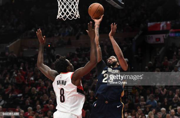 Anthony Davis of the New Orleans Pelicans shoots the ball over AlFarouq Aminu of the Portland Trail Blazers during the first quarter of game one of...