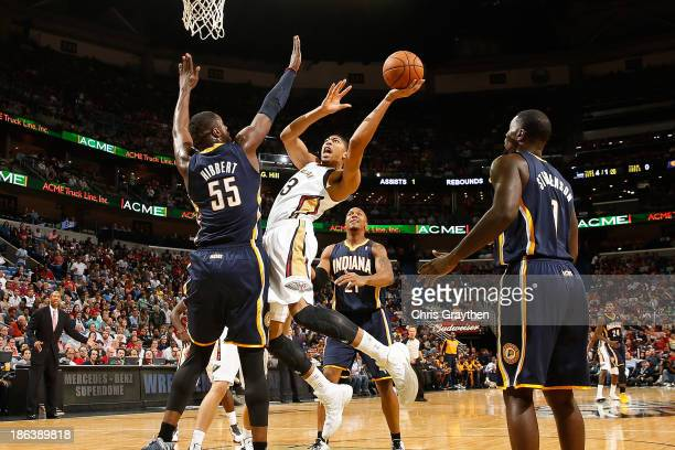 Anthony Davis of the New Orleans Pelicans shoots the ball over Roy Hibbert of the Indiana Pacers at the New Orleans Arena on October 30, 2013 in New...
