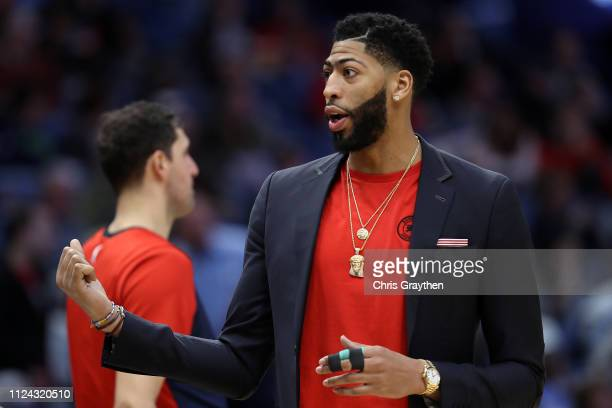 Anthony Davis of the New Orleans Pelicans sits on the bench with an injury in his finger during the game against the Detroit Pistons at Smoothie King...