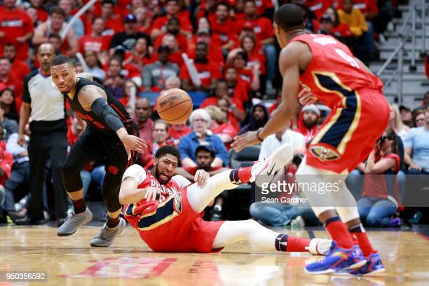 Anthony Davis of the New Orleans Pelicans steals the ball from Damian Lillard of the Portland Trail Blazers during Game 3 of the Western Conference...