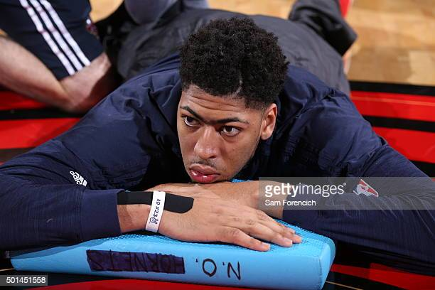 Anthony Davis of the New Orleans Pelicans stretches before the game against the Portland Trail Blazers on December 14 2015 at the Moda Center Arena...